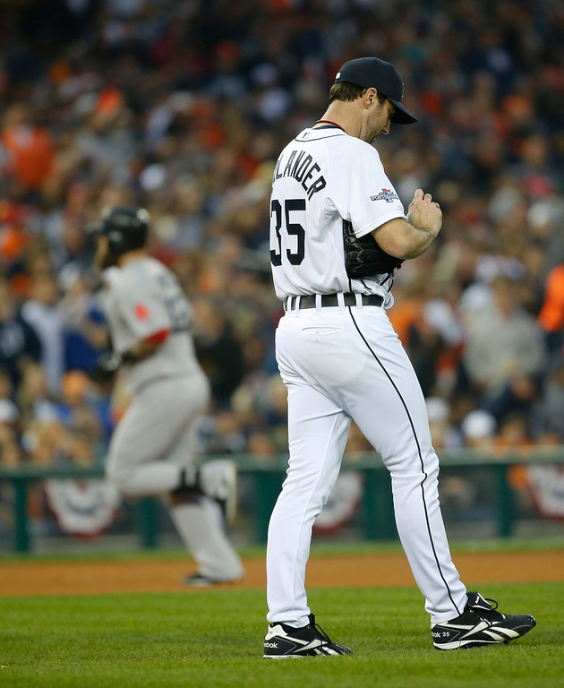 . Detroit Tigers\' Justin Verlander looks down after giving up a home run to Boston Red Sox\'s Mike Napoli in the seventh inning during Game 3 of the American League baseball championship series Tuesday, Oct. 15, 2013, in Detroit. (AP Photo/Paul Sancya)