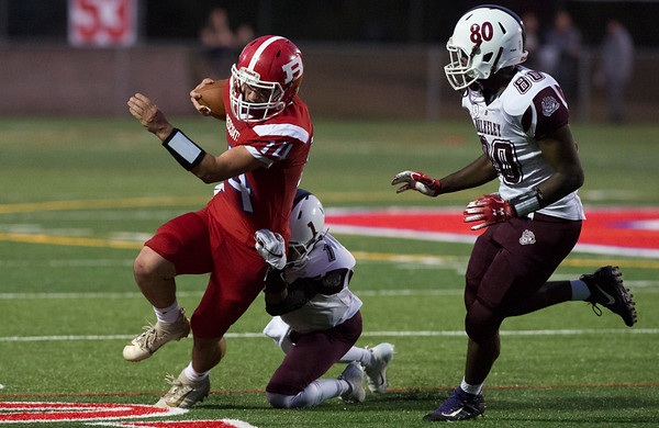 09/20/19 Wesley Bunnell | StaffrrBerlin football defeated Bulkeley on Friday night at Sage Park. Elijah Crowley (14) tries to find running room down the sideline.