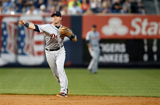 . Detroit Tigers Andrew Romine (27) throws to first for a putout in a baseball game against the New York Yankees at Yankee Stadium in New York, Tuesday, Aug. 5, 2014.  (AP Photo/Kathy Willens)