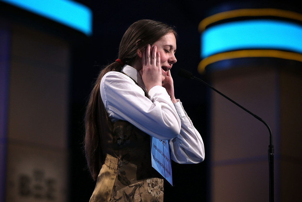 . NATIONAL HARBOR, MD - MAY 30:  Mary Geneve Skirvin of Nashville, Indiana, tries to spell her word during round five of the 2013 Scripps National Spelling Bee May 30, 2013 at Gaylord National Resort and Convention Center in National Harbor, Maryland. Forty-two have advanced to the semifinal of the annual spelling contest for the championship.  (Photo by Alex Wong/Getty Images)