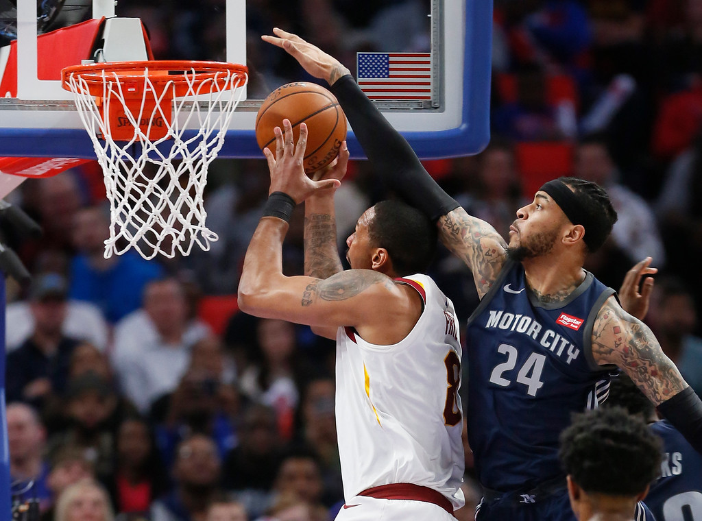 . Detroit Pistons forward Eric Moreland (24) defends against a shot by Cleveland Cavaliers forward Channing Frye (8) during the first half of an NBA basketball game Tuesday, Jan. 30, 2018, in Detroit. (AP Photo/Duane Burleson)