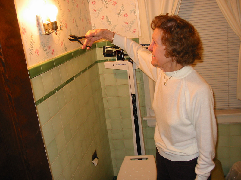 Mom demonstrating how she turns the light in the bathroom on and off. Her method rather surprised us.