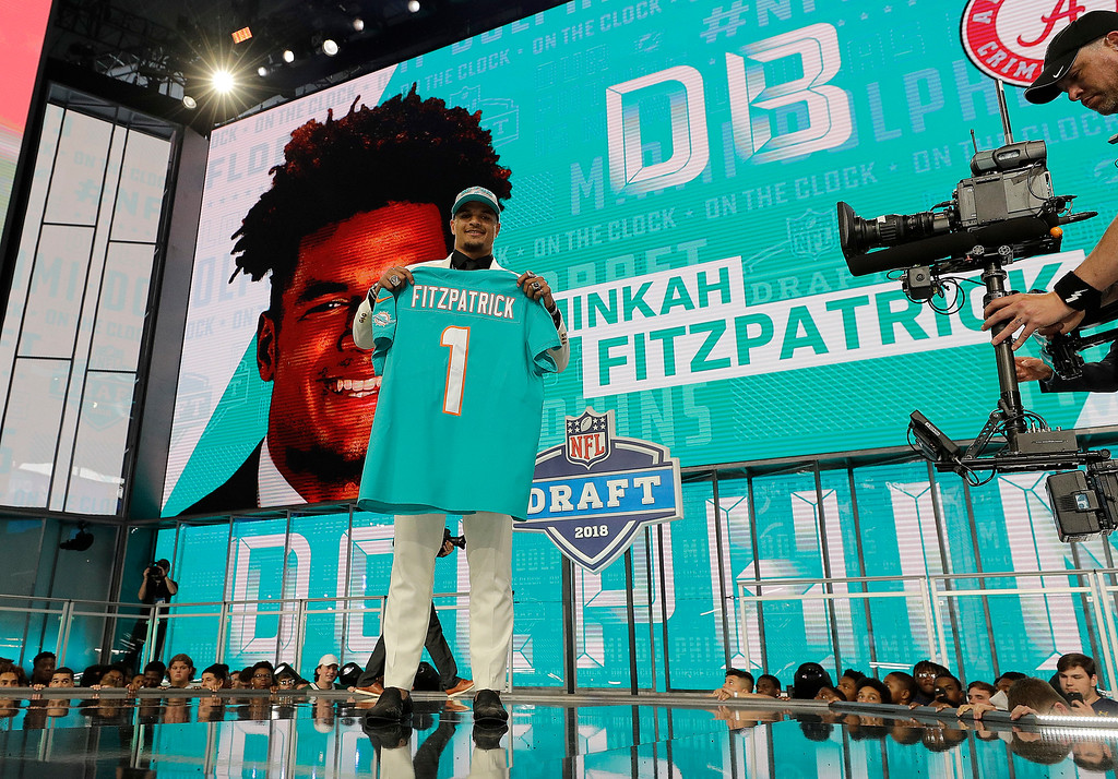 . Alabama\'s Minkah Fitzpatrick holds his Miami Dolphins jersey after being selected by the team during the first round of the NFL football draft, Thursday, April 26, 2018, in Arlington, Texas. (AP Photo/David J. Phillip)