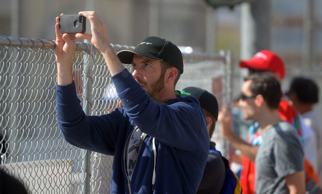 . Race fans take photos of the Indy practice in Long Beach, CA on Friday, April 17, 2015. The 40th annual Toyota Grand Prix of Long Beach kicked off with practices for all of the racing divisions. (Photo by Scott Varley, Daily Breeze)