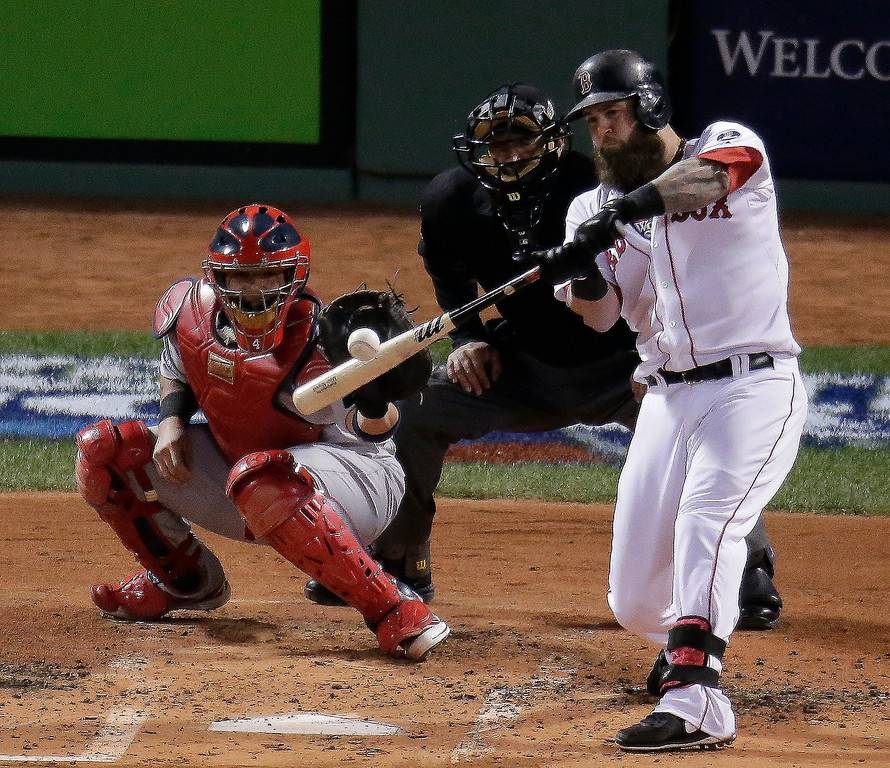 . Boston Red Sox\'s Mike Napoli hits a three-run scoring double during the first inning of Game 1 of baseball\'s World Series against the St. Louis Cardinals Wednesday, Oct. 23, 2013, in Boston. (AP Photo/Charlie Riedel)