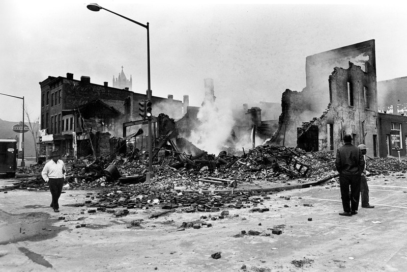 . Smouldering ruins remain where a building stood on 7th Street, N.W. in Washington, D.C., April 6, 1968.  Numerous fires accompanied the second night of turmoil in the nation\'s capital following the assassination of Dr. Martin Luther King, Jr., in Memphis, Tenn., April 4.  (AP Photo)