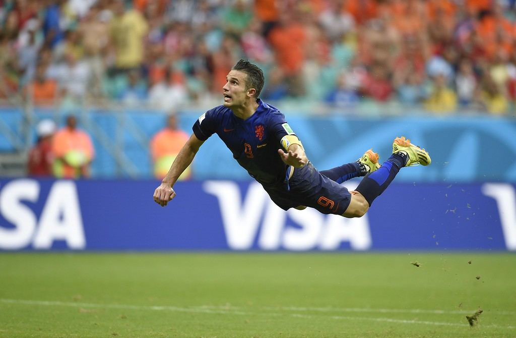 . Netherlands\' forward Robin van Persie scores during a Group B football match between Spain and the Netherlands at the Fonte Nova Arena in Salvador during the 2014 FIFA World Cup on June 13, 2014.   AFP PHOTO / LLUIS  GENE/AFP/Getty Images