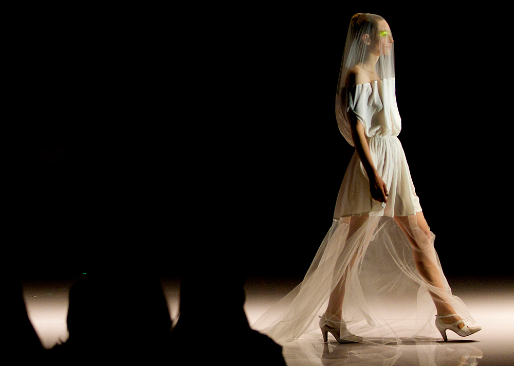 Description of . A model wears a creation of Israeli designer Hagit Witman by her brand \'Fishndag\' during a show at the Tel Aviv fashion week in Israel, Wednesday, Dec. 19, 2012. (AP Photo/Ariel Schalit)