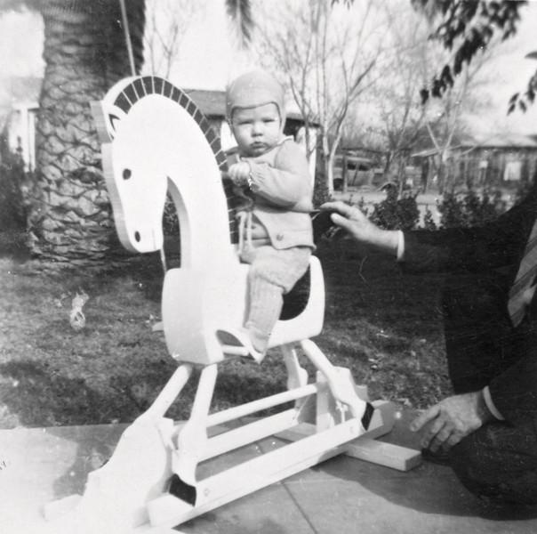 Phil on rocking horse 12/1943