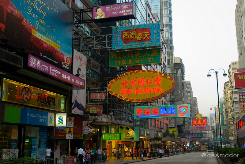 aeamador©-HK08_DSC0196.      Hong Kong. Kowloon. Tsim Sha Tsui. Though not to be compared with what you find in Hong Kong island, it is quite a vibrant and lively city. People fill up the streets and sidewalks day and night for shopping, entertainment and more. Signs make a great show, especially at night, giving vibrancy and character to the city.