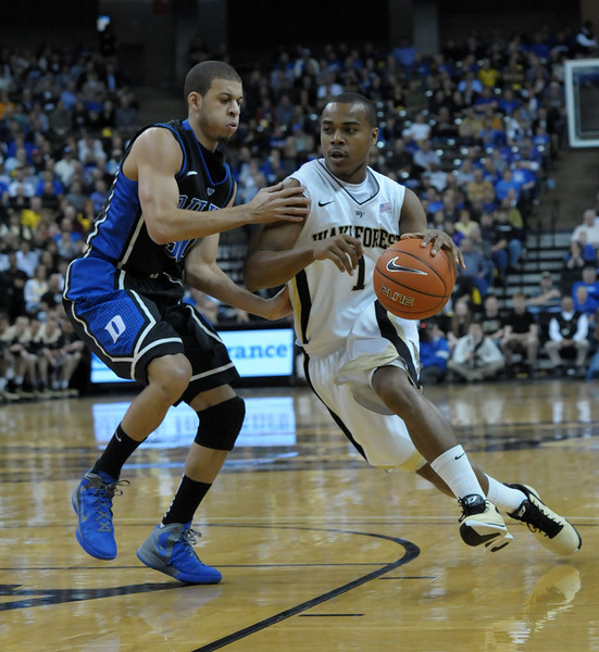 Tony Chennault drives against S Curry.jpg