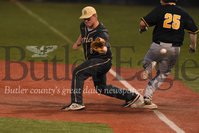 Butler's J. R. Herold extends to try to make a play at first in the Golden Tornado's loss to North Allegheny Monday night.