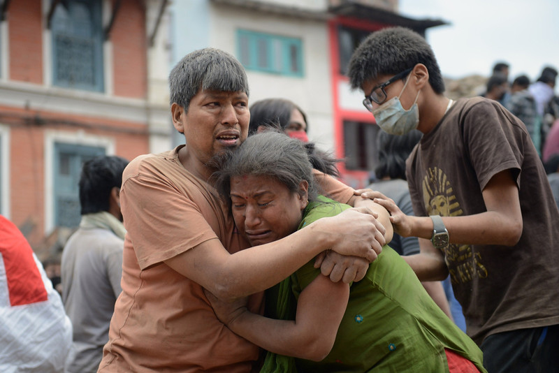 . A Nepalese man and woman hold each other in Kathmandu\'s Durbar Square, a UNESCO World Heritage Site that was severely damaged by an earthquake on April 25, 2015. A massive 7.8 magnitude earthquake killed hundreds of people April 25 as it ripped through large parts of Nepal, toppling office blocks and towers in Kathmandu and triggering a deadly avalanche that hit Everest base camp. PRAKASH MATHEMA/AFP/Getty Images