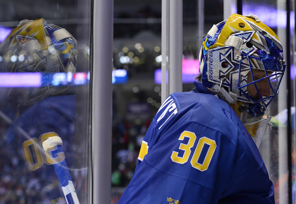 . Sweden\'s goalkeeper Henrik Lundqvist leaves the ice during the Men\'s Ice Hockey Group C match Czech Republic vs Sweden at the Bolshoy Arena during the Sochi Winter Olympics on February 12, 2014. Sweden won 2-4.    JONATHAN NACKSTRAND/AFP/Getty Images