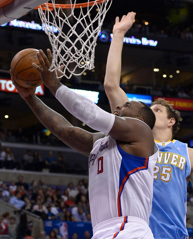 . Clippers#0 Glen Davis gets past Nuggets #25 Timofey Mozgov in the first half. The Los Angeles Clippers took on the Denver Nuggets in a regular season NBA game. Los Angeles, CA. 4/15/2014(Photo by John McCoy / Los Angeles Daily News)