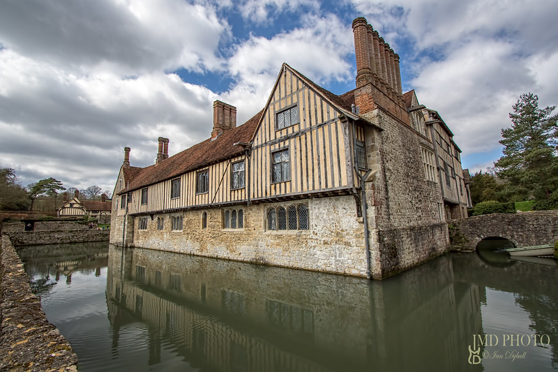 Medieval English buildings surrounded by moat