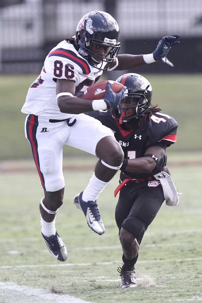Tiko Thompson (41) pushes Samford out of bounds
