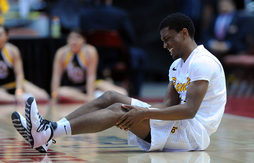 . LBSU\'s Branford Jones winces after injuring his leg in the 1st half at the Honda Center in Anaheim, CA on Thursday, March 13, 2014. Long Beach State vs CSU Fullerton in the Big West men\'s basketball tournament. 1st half. LBSU won 66-56.  Photo by Scott Varley, Daily Breeze)