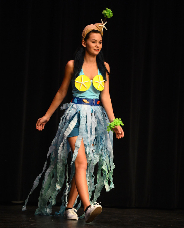 . Kat Mecham\'s creation has an ocean theme as she models it at the third annual Paper Skirt Fashion Show held at Liberty High School in Brentwood, Calif.  on Tuesday, Jan. 29, 2013.  Extra credit was given to those who also designed a top and accessories in addition to the paper skirt.  (Susan Tripp Pollard/Staff)