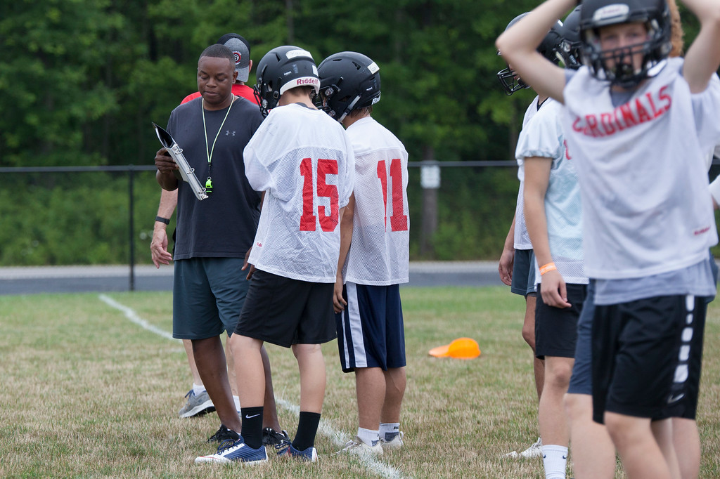. Jen Forbus - The Morning Journal<br> The Brookside coaching staff instructs the players on routes and the play book during Brookside\'s first day of football practice on July 30.