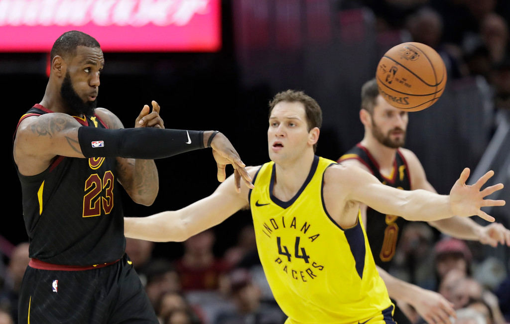 . Cleveland Cavaliers\' LeBron James, left, passes against Indiana Pacers\' Bojan Bogdanovic, from Croatia, in the second half of Game 1 of an NBA basketball first-round playoff series, Sunday, April 15, 2018, in Cleveland. (AP Photo/Tony Dejak)