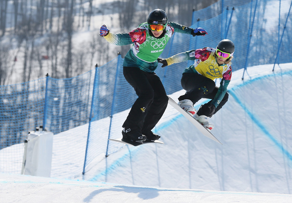 . Belle Brockhoff (L) and Torah Bright of Australia compete in the Women\'s Snowboard Cross quarter final at Rosa Khutor Extreme Park at the Sochi 2014 Olympic Games, Krasnaya Polyana, Russia, 16 February 2014.  EPA/SERGEY ILNITSKY