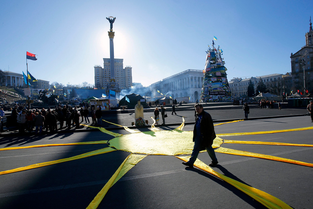 . A Ukrainian man passes over the a symbolic sun ray, created as an artwork on the pavement of Independence Square, in Kiev, Ukraine, 12 March 2014. The USA and European Union have threatened sanctions against Moscow over the military standoff in the strategic Crimean peninsula, and are urging Russia to pull back its forces in the region and allow in international observers and human rights monitors. Crimea, which has a majority ethnic Russian population, is strategically important to Russia as the home port of its Black Sea Fleet.  EPA/ROBERT GHEMENT