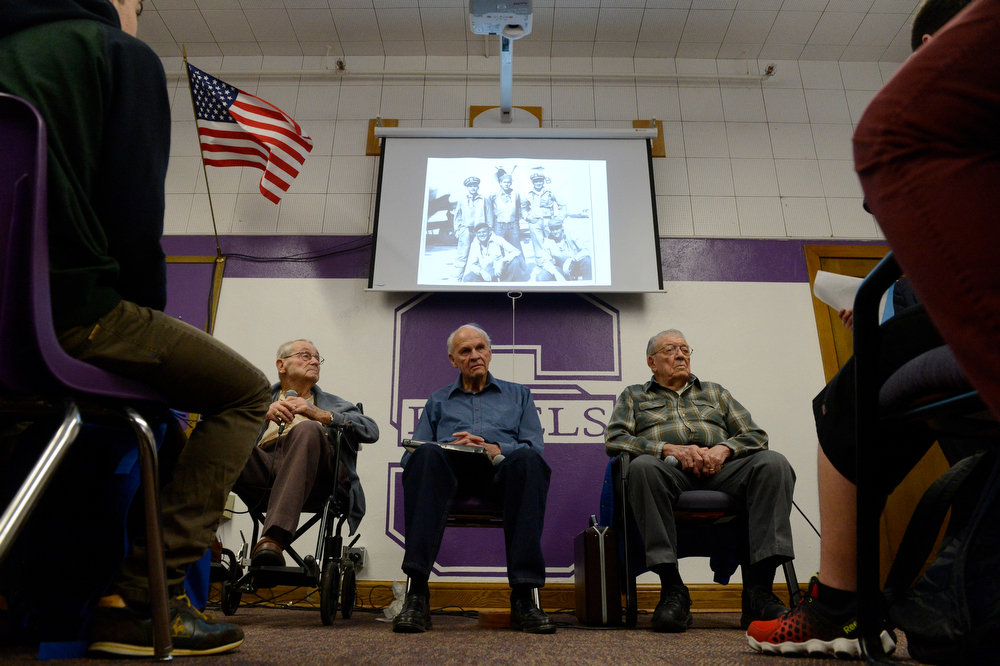 . WWII veterans from left to right, Harold Haberman, U.S. Marine Corp., Carl Hammergren, U.S. Navy, and Earl Lammers, U.S. Army Corp. wait to address and answer questions about their service in WWII as part of Cristina Chacon\'s U.S. History class at South High School Wednesday morning, February 12, 2014. Wednesday marked the second annual visit from WWII veterans, visiting from the Clermont Park Retirement Community in Denver. The veterans told their stories about their experiences in the war and answered many questions from the kids and also greeted them afterward.  (Photo By Andy Cross / The Denver Post)