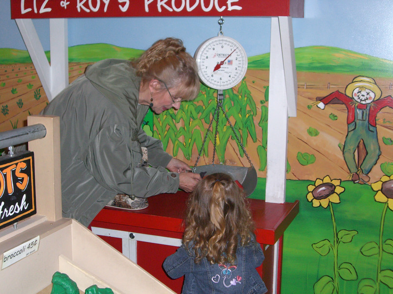 Weighing and sorting fruits and vegetables with Grandmama - at the Everett Children's Museum.