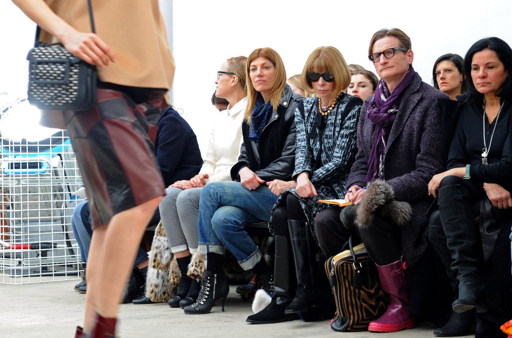 Description of . Anna Wintour and Hamish Bowles attend the Derek Lam fall 2013 fashion show during Mercedes-Benz Fashion Week at Sean Kelly Gallery on February 10, 2013 in New York City.  (Photo by Craig Barritt/Getty Images)