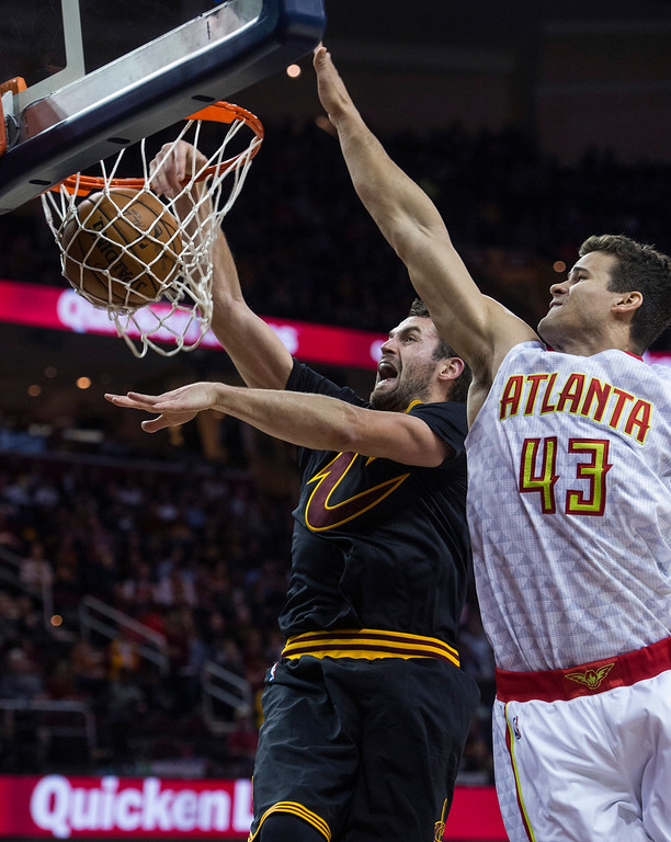 . Cleveland Cavaliers\' Kevin Love dunks as Atlanta Hawks\' Kris Humphries (43) defends during the first half of an NBA basketball game in Cleveland, Tuesday, Nov. 8, 2016. (AP Photo/Phil Long)