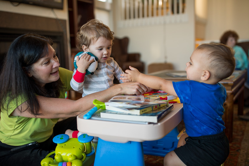 Mom playing with Caleb and Brady at the table 2.jpg