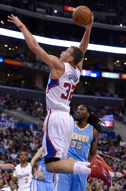 . Clippers#32 Blake Griffin goes up for a dunk while Nuggets #35 Keneth Faried looks on. The Los Angeles Clippers took on the Denver Nuggets in a regular season NBA game. Los Angeles, CA. 4/15/2014(Photo by John McCoy / Los Angeles Daily News)