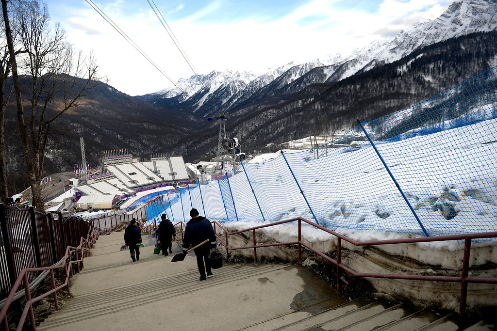 . ROSA KHUTOR, RUSSIA - FEBRUARY 09: Workers navigate the massive set of stairs separating the Rosa Khutor Extreme Park from the gondola after the day\'s events have concluded. Sochi 2014 Winter Olympics at the Rosa Khutor Extreme Park on Sunday, February 9, 2014. (Photo by AAron Ontiveroz/The Denver Post)
