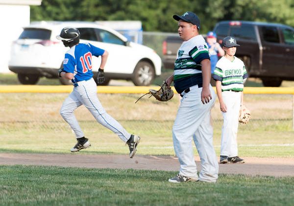 07/13/18 Wesley Bunnell | Staff Edgewood Little League was defeated 4-3 by Wallingford on Friday night in Southington. Edgewood pitcher Oscar Kuzniar (52) stands off the mound as Wallingford Kevin Milewski (10) rounds the bases after hitting a two run home run in the bottom of the 5th to give Wallingford a 4-3 lead which would prove to be the difference in the game.