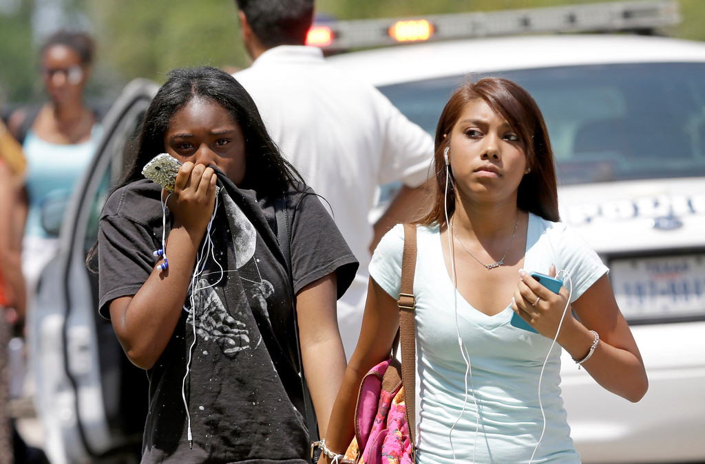 . Students walk to their waiting parents outside Spring High School Wednesday, Sept. 4, 2013, in Spring, Texas. (AP Photo/David J. Phillip)