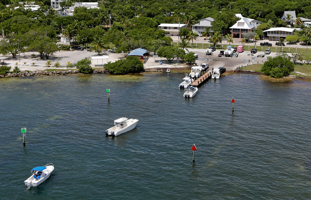 . Boats wait in line to haul their boats north Tavernier, Fla., on US 1, in anticipation of Hurricane Irma on Wednesday, Sept. 6, 2017. Keys officials announced a mandatory evacuation Wednesday for visitors, with residents being told to leave the next day. (AP Photo/Alan Diaz)