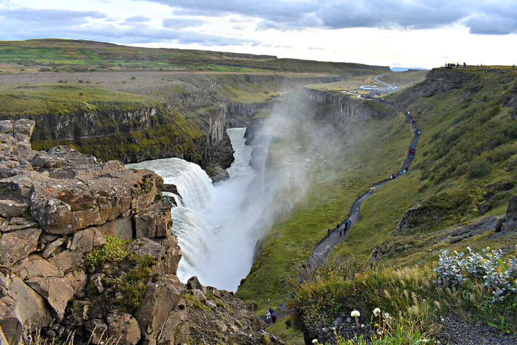 View from the cliffs overlooking Gullfoss waterfall Iceland rainbow