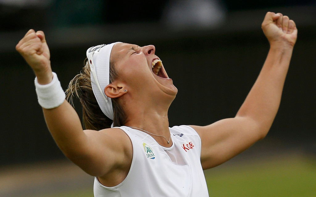 . Kirsten Flipkens of Belgium celebrates after defeating Petra Kvitova of the Czech Republic in their women\'s quarter-final tennis match at the Wimbledon Tennis Championships, in London July 2, 2013.     REUTERS/Eddie Keogh