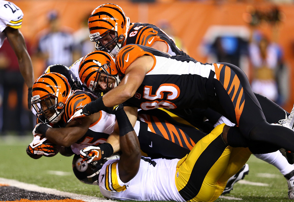 . Running back Giovani Bernard #25 of the Cincinnati Bengals dives into the endzone for a seven-yard touchdown run in the first quarter against the Pittsburgh Steelers in the first half at Paul Brown Stadium on September 16, 2013 in Cincinnati, Ohio.  (Photo by Andy Lyons/Getty Images)