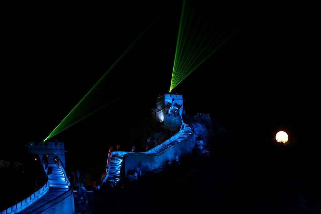 . Laser lights shoot from towers during a New Year\'s Eve count down to 2014 held at the Great Wall of China in Beijing, China, Tuesday, Dec. 31, 2013. (AP Photo/Ng Han Guan)
