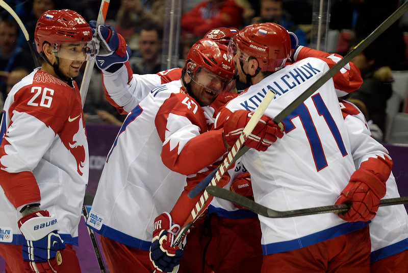 . Teammates celebrate with Pavel Datsyuk (13) of the Russia after his 1-0 goal against the U.S.A. during the second period of men\'s hockey action at Bolshoy arena. Sochi 2014 Winter Olympics on Saturday, February 15, 2014. (Photo by AAron Ontiveroz/The Denver Post)