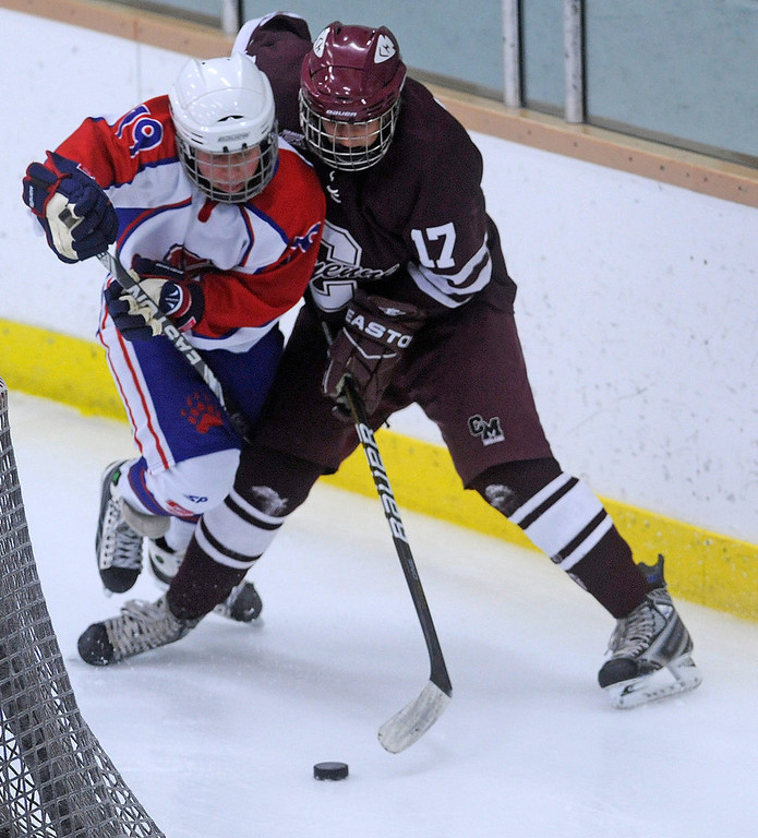 . Cheyenne Mountain\'s Keaton Allison, right,  and Cherry Creek\'s Ryan Worley fight for the puck during the second period of play in 5A High School Hockey action at Family Sports Center in Englewood, CO Saturday December 8, 2012. (Photo by Evan Semon, Special to The Denver Post)