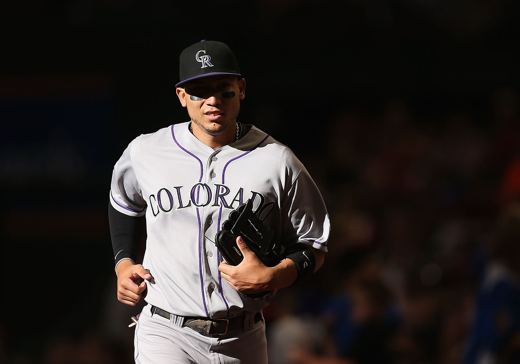 . Carlos Gonzalez #5 of the Colorado Rockies runs into the dugout before the MLB game against the Arizona Diamondbacks at Chase Field on April 27, 2013 in Phoenix, Arizona.  (Photo by Christian Petersen/Getty Images)