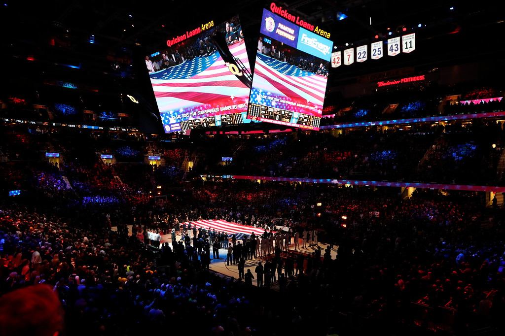. The national anthem is played before Game 3 of basketball\'s NBA Finals between the Cleveland Cavaliers and the Golden State Warriors, Wednesday, June 6, 2018, in Cleveland. (AP Photo/Carlos Osorio)