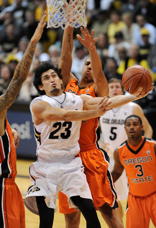 . Sabatino Chen of CU goes to the hoop against OSU during the second half of the March 9, 2013 game in Boulder.    (Cliff Grassmick/Boulder Daily Camera)