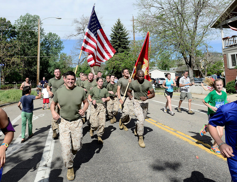 . A group of Marines run in the Bolder Boulder in Boulder, Colorado May 27, 2014.  DAILY CAMERA/ Mark Leffingwell