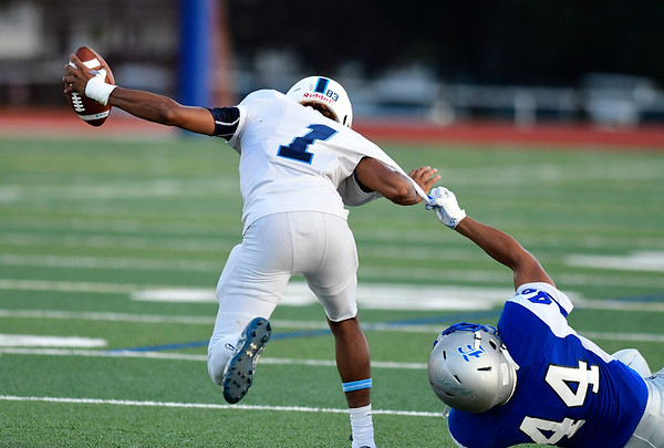 9/14/2018 Mike Orazzi | Staff Bristol Eastern's Edgar Santiago (44) and Middletown's Jonta'e Dempsey-Brown (1) during Friday night's football game with Middletown in Bristol.