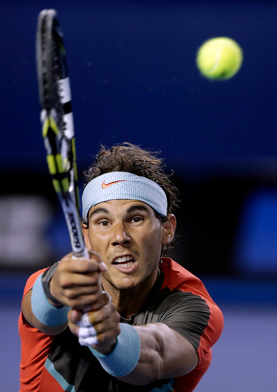 . Rafael Nadal of Spain makes a backhand return to Stanislas Wawrinka of Switzerland during the men\'s singles final at the Australian Open tennis championship in Melbourne, Australia, Sunday, Jan. 26, 2014.(AP Photo/Rick Rycroft)