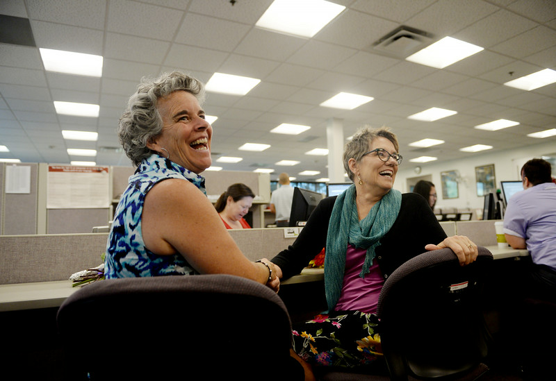 . Newlyweds Bylo Farmer, left, and Angie Holley, of Boulder, turn an smile at their friends as the two get their marriage license at the Boulder County Clerk and Recorder\'s Office, June 26, 2014. The state of Utah\'s same-sex marriage ban was struck down by the 10th Circuit Supreme Court. (Photo by RJ Sangosti/The Denver Post)
